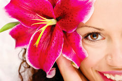 Big flower in woman's hair. Close up of a woman's eye and flower in her hair Stock Photography