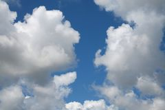 Clouds. Big, fluffy, billowy cumulus clouds gather in the Florida skies Stock Photography