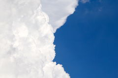 Big Fluffy Cloud contrast blue skies Stock Photo