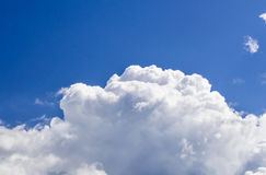 A big and fluffy cumulonimbus cloud in the blue sky Royalty Free Stock Image