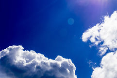 A big and fluffy cumulonimbus cloud in the blue sky Stock Image