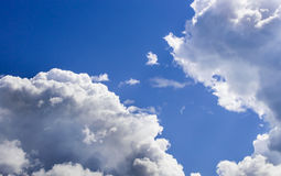 A big and fluffy cumulonimbus cloud in the blue sky Royalty Free Stock Photos
