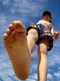 Big foot. Of child walking stock photos