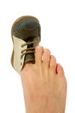 Big foot small shoe Royalty Free Stock Image