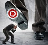 Big foot steps on businessman Stock Photography