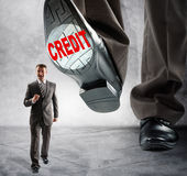 Big foot steps on businessman Royalty Free Stock Images