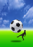 Big Football. Football - kick, focus on ball with drama in back ground with blue Stock Photo