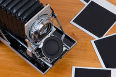 Big format camera with empty pictures Stock Photos