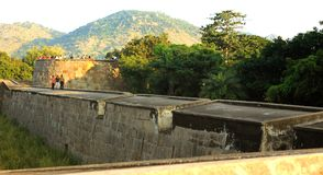 People on the big fort battlement and large wall at vellore fort with sunset Royalty Free Stock Photo
