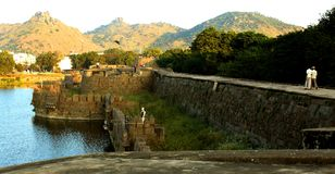 People on the big fort battlement and large wall at vellore fort with sunset Stock Photos