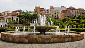 Big fountain with nice houses Tuscany Style and beautiful park Stock Images