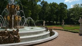 Big fountain in the Summer Garden in sunny day Royalty Free Stock Photography