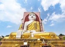 Big four Buddha statues or  Kyaik Pun pagoda in Bago , Myanmar. On blue sky background Stock Images