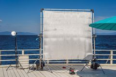 A big frame of a silk textile used for softening of the hard light on a cinema production set stock images