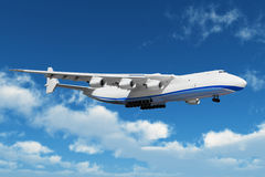 Big freight airiner in the bue sky with clouds. Big freight airiner in the midair royalty free stock photos