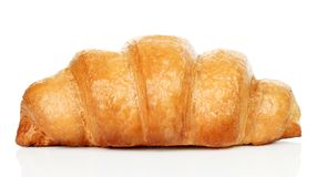 Big fresh croissant on white background royalty free stock images