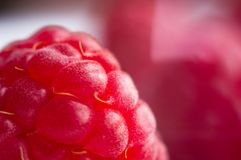 Raspberries on a white saucer close up, macro photo. Big fresh juicy raspberries on a white saucer close up, macro photo, selected focus Stock Images