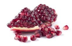 Big fresh piece of pomegranate  on white background Stock Image