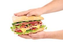 Big fresh sandwich in hands. Stock Image