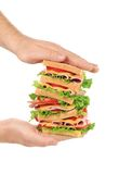 Big fresh sandwich in hands. Royalty Free Stock Image