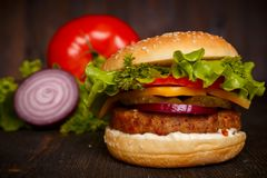 Big fresh tasty burger with vegetables Royalty Free Stock Photography