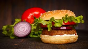 Big fresh tasty burger with vegetables Stock Photography