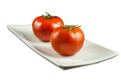Big Fresh Tomatoes in White Plate Royalty Free Stock Photos