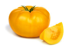 Big fresh yellow tomato. Big fresh yellow tomato isolated on white background royalty free stock photos