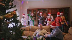 Big friendly family gathering for traditional Christmas celebration at home