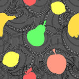 Big Friuts. Decorative apples and other colored fruits on the gray background Royalty Free Stock Photos