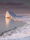 Big frozen rock Stock Image