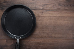 Big frying pan on the table Stock Photos