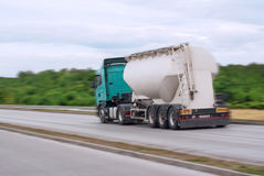 Big fuel gas tanker. On the road motion blur Stock Photos