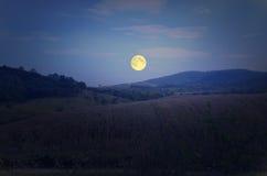 Big full moon over the mountain. Beautiful full moon over the mountain in winter Royalty Free Stock Photo