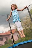 Big fun - child jumping trampoline Stock Photo