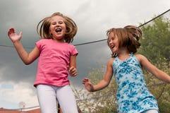Big fun - childdren jumping royalty free stock photos