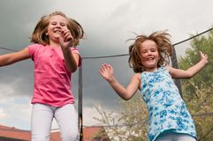 Big fun - childdren jumping trampoline Royalty Free Stock Images