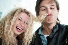 Big fun - couple playing with hair Stock Photos