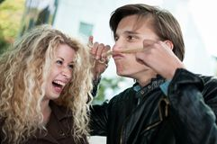 Big fun - couple playing with hair Stock Images