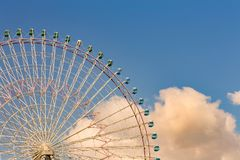 Big funfair ferris wheel with blue sky. Background royalty free stock images
