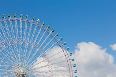 Big funfair ferris wheel with clear blue sky. Background Stock Image