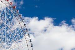 Big funfair festival ferris wheel against blue sky. Background Stock Photography