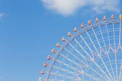 Big funfair festival wheel against blue sky. Background Stock Photos