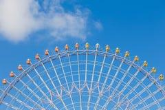 Big funfair giant ferris wheel against blue sky. Background Royalty Free Stock Image