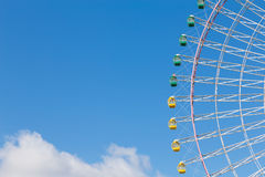 Big funfair giant ferris wheel with blue sky. Background Royalty Free Stock Image