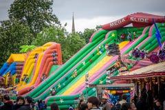 Big funfair. Big big inflatable mega slides in an outdoor funfair playground Stock Photo