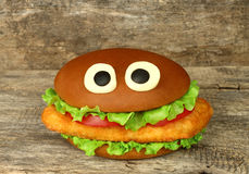 Big funny hamburger whith cheese eyes and chicken cutlet Royalty Free Stock Photos
