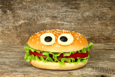 Big funny hamburger whith cheese eyes Stock Photography