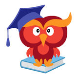 Big funny wise owl sitting on the blue book Royalty Free Stock Photos