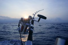 Big game boat fishing in deep sea. On boat stock photo